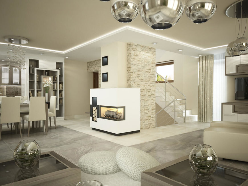 Opposite the seating area of the living room is a bold fireplace. Along the right side of the room is the built in entertainment stand, housing a flat screen TV and all the components in mirrored cabinets, as well as a built in bookshelf similar to the one just past the dining room table to the left of the room.