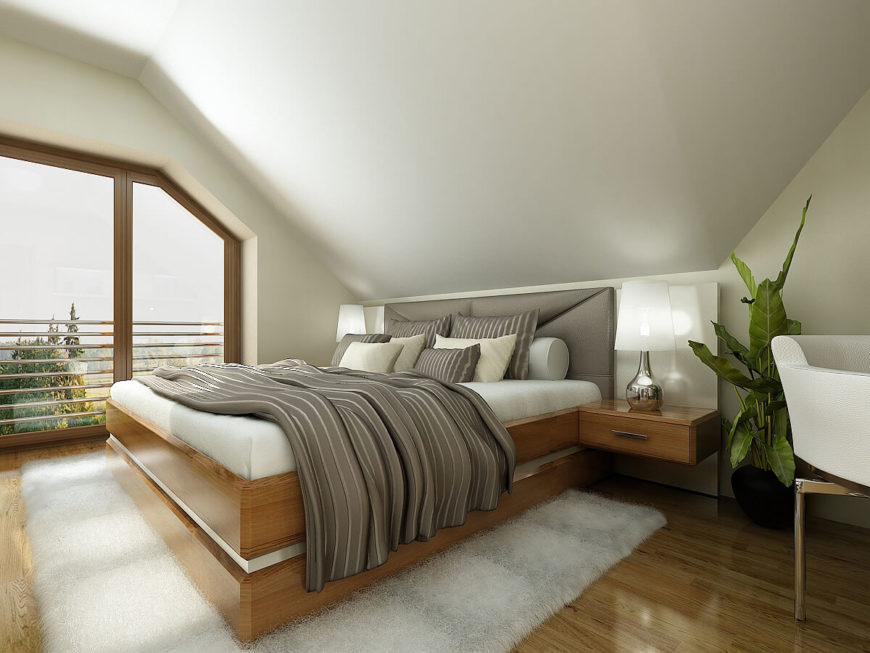 The second bedroom utilizes the same bold textures as the first with a lightened color scheme and a padded headboard.