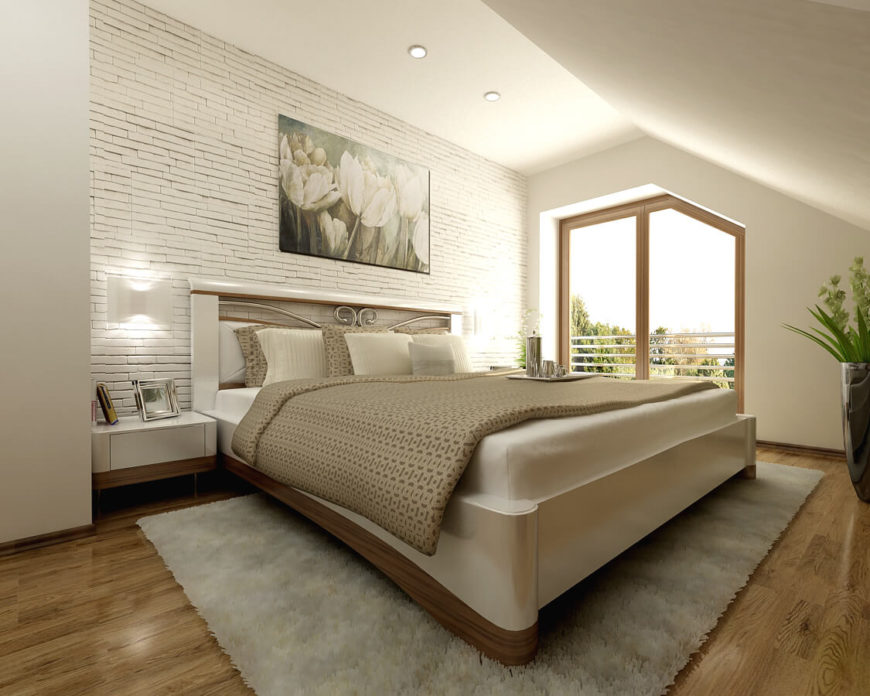 The master bedroom uses the wood from the other bedrooms in a more understated fashion. It accents the bottom of the bed frame and bedside tables and balances out the extensive use of white in the room. More bold texturing is apparent in here as well.