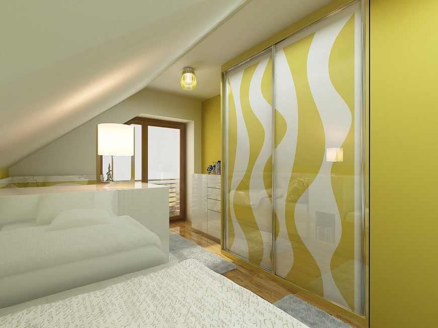 The swooping lines of the beds are replicated in the reflective closet doors. Texture is added to the room by way of thick rugs and script covered bed comforters.