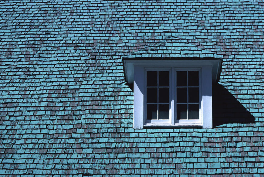 This cedar roof takes the prize for the most unique coloring. Here we can see incredible hues of blue and black that correspond beautifully on one roof.