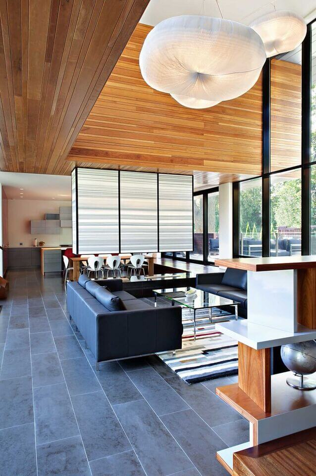 The Half Wall Extending From Ceiling And Separating Living Room Dining