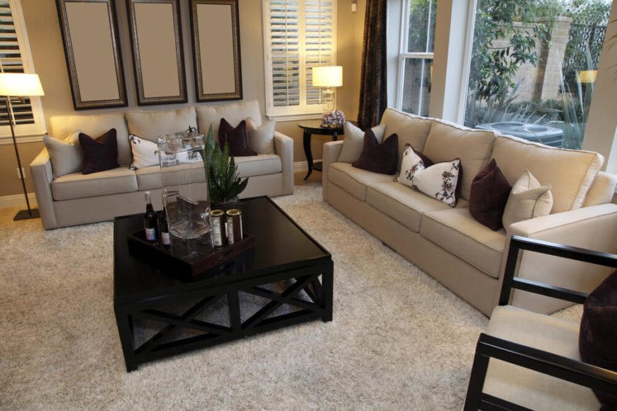 Beiges, Creams, And Deep Chocolate Brown Work Together To Create A Small  Living Area