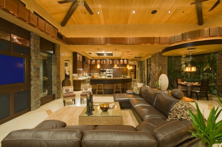 A Beautiful Living Room Space Rich In Earth Tones And Varied Textures. The  Overstuffed Leather