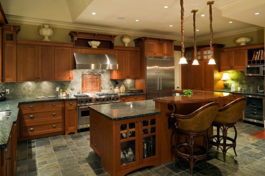 This kitchen has breathtaking amber wood throughout the design, as well has a diamond patterned backsplash, which brings out the colors in the cabinets. Pendant and pot lighting provide ample light.