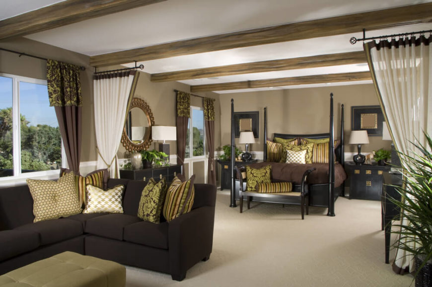 The Chocolate Brown Sectional With Patterned Throw Pillows Ties The Room  Together By Matching The Decorative