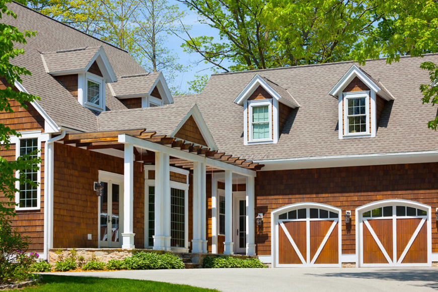 This magnificent home shows off it's modern day cedar shingles. The taupe color of the shingles really brings out a contrast against the deep brown colors in the siding.