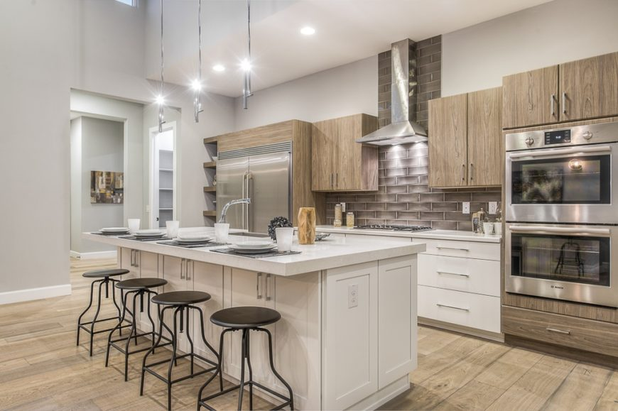 This Kitchen Has A Classic Atmosphere Cloud White Island Stands Tall In The Center