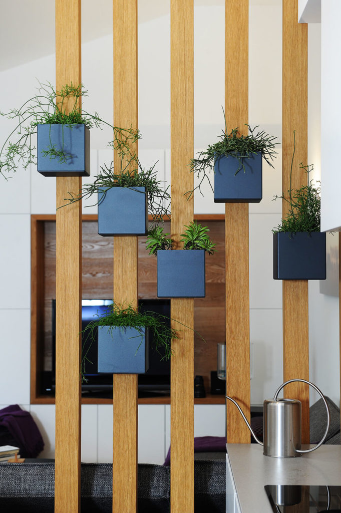 Here's a close-up of the oak partition bars, with a series of cubic container gardens housing spices. The mixture of style and function exemplifies the design of this home.