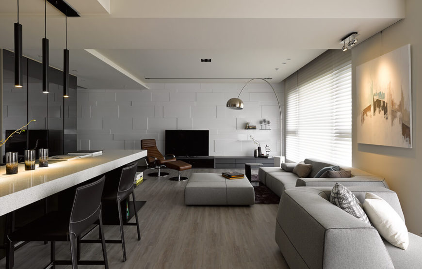 When taken together as a while, we see how the open space can accommodate many different configurations of the furniture, while the hardwood flooring in this space acts as a unifying element.