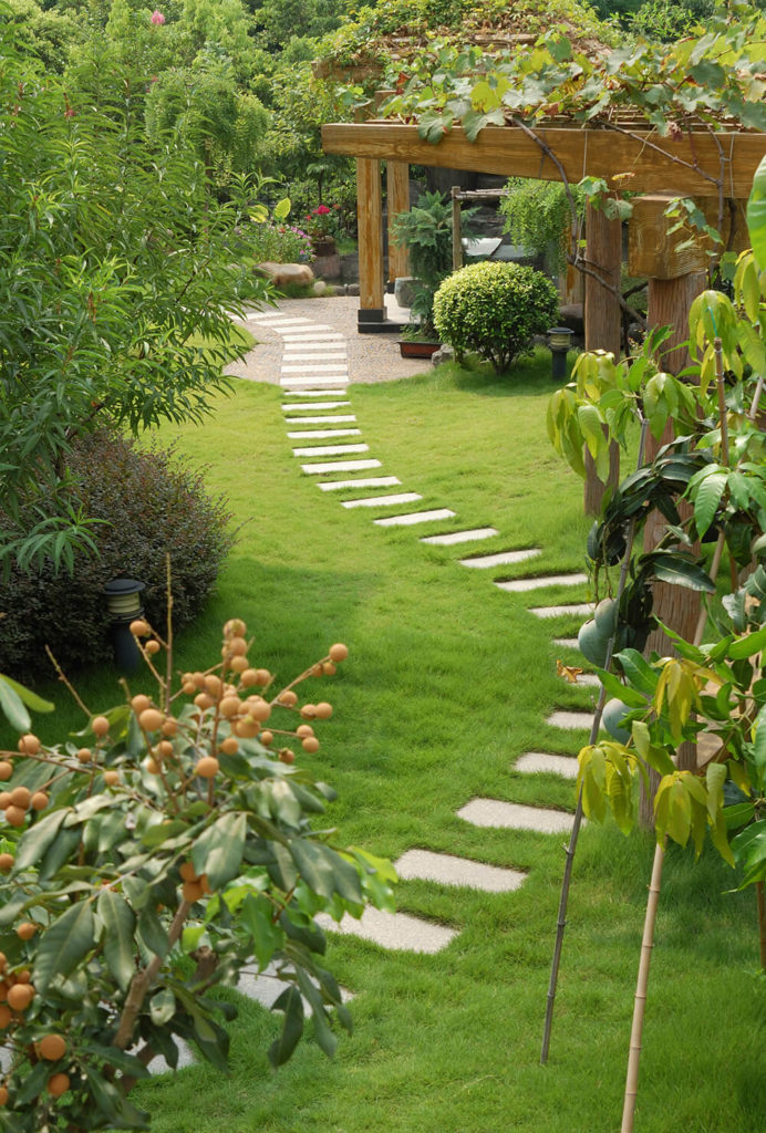 This garden is incredibly peaceful and quaint. A flawless walkway moves  through the tall trees