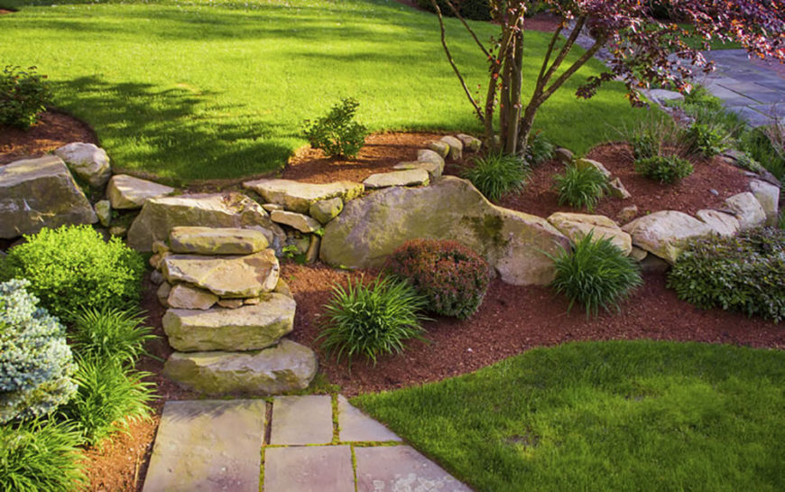 this beautiful sand colored walkway and border stand out well against the green and red - Backyard Landscaping