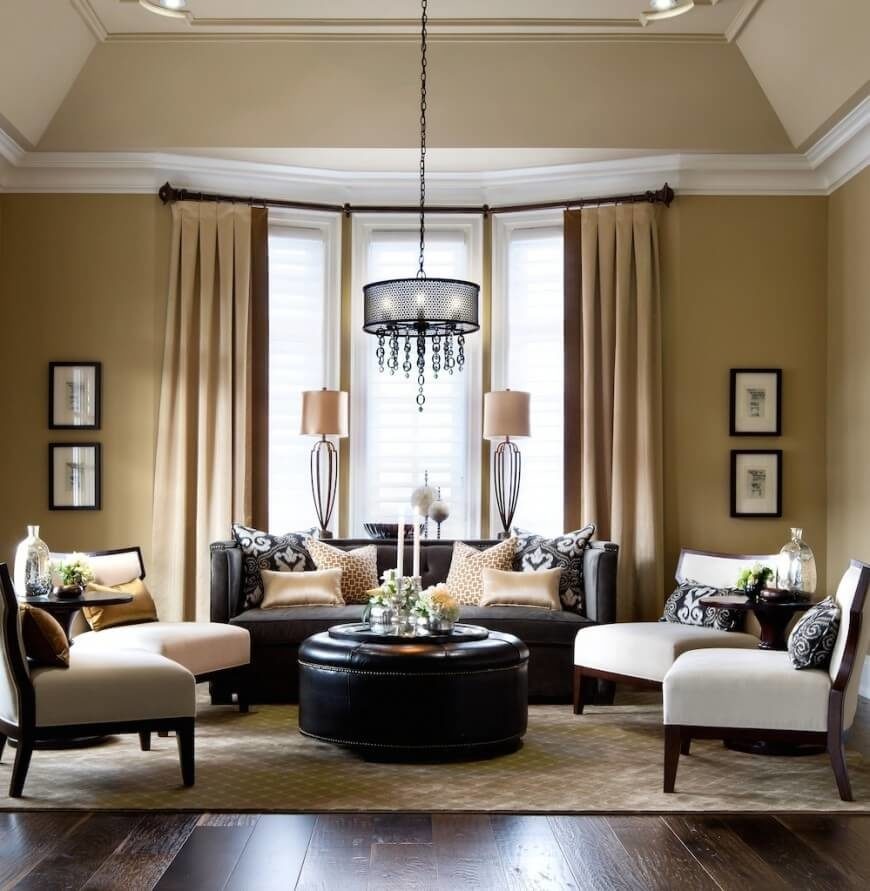 While primarily comprised of tans, creams and deep browns, the bold black leather of the furniture and coordinating accents cannot be overlooked. Earth tones abound, and the ebony of the leather sofa and circular ottoman provide sensational contrast.
