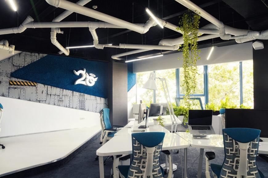 Here we can see the hand-drawn comic style decals on the wall, as well as the 2O logo. A healthy green vines spills down from the ceiling and around the office for a bright color scheme against the blues and whites.