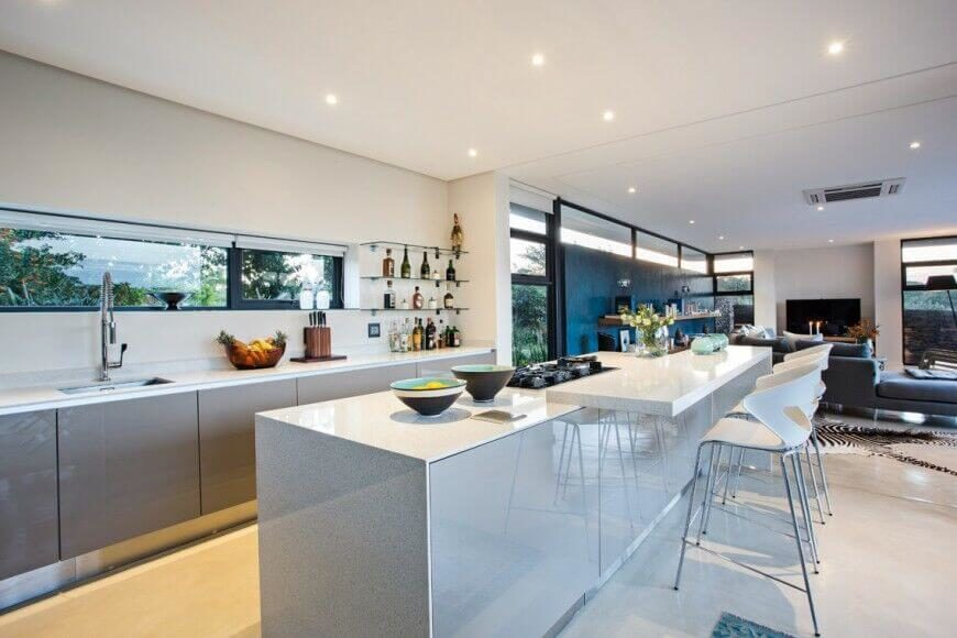 In a sprawling open-plan space that includes living and dining areas, this  kitchen