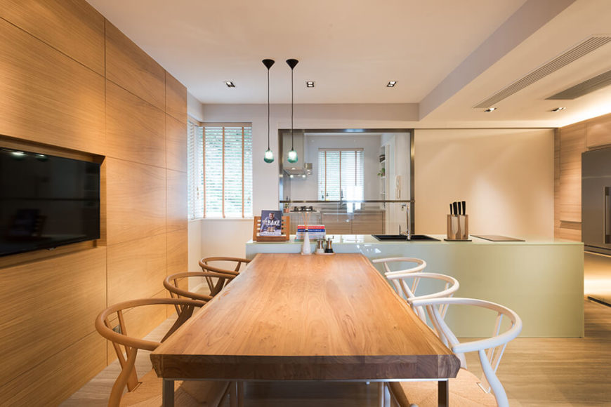 The house boasts two full kitchens; one of a more open style for Western cooking and entertaining and a smaller enclosed kitchen for Asian style cooking. The solid oak table is meant to counter the high-gloss finish of the kitchen counters.
