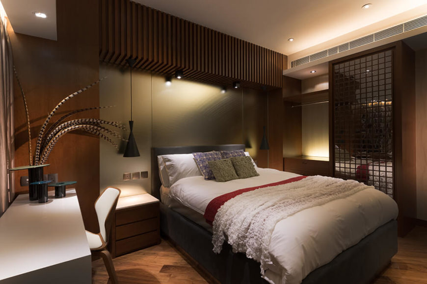 The first of two guests rooms follows the feeling invoked by the master bedroom. The use of a metallic wall and the glass feature is meant to give the room the illusion of space.