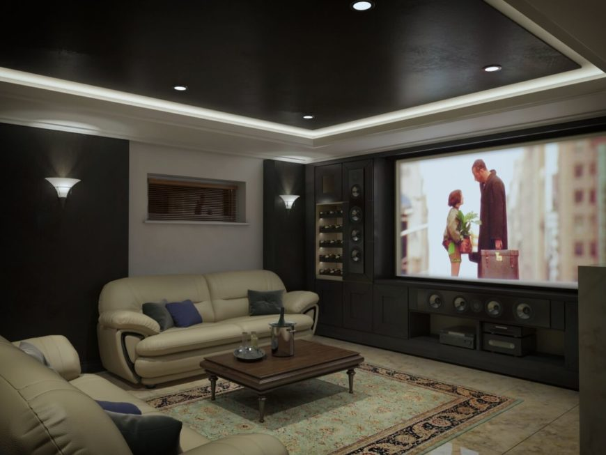 No luxury home is complete without an equally luxurious family/screening room. The impressively large television should be out of place, but somehow works perfectly with the art-deco inspired modern lines of the furniture, traditional area rug, and dark ceiling with recessed lighting.