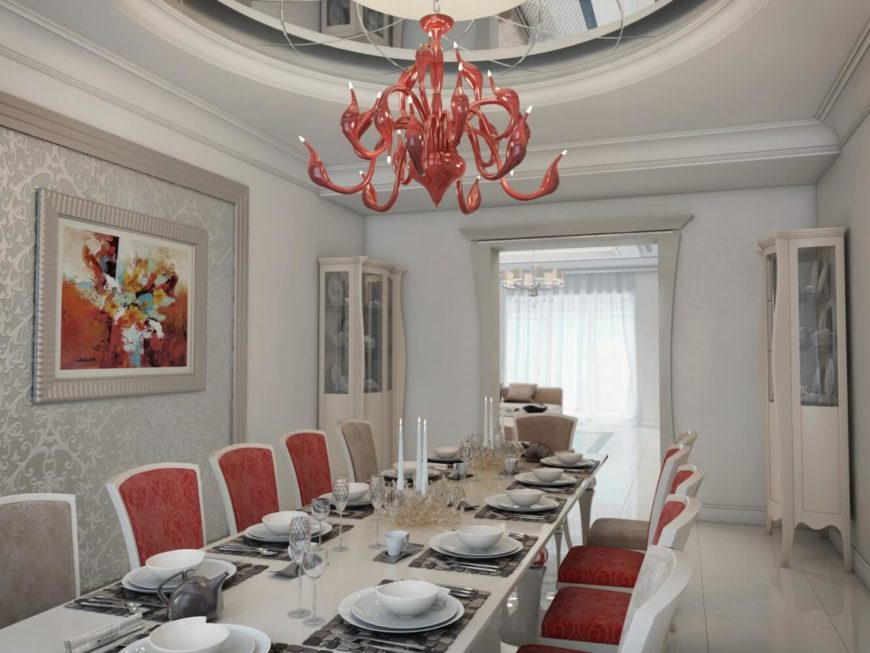 The formal dining room shocks and titillates the senses with its bold design risks. While still remaining true to traditional tones, the crimson red accent chairs, modern tentacle-like chandelier, and bold coordinating artwork offer a welcome respite from the comfortable taupes featured through the rest of the home. The domed ceiling is also a scene stealer, and reinforces the elegance of the room as a whole.