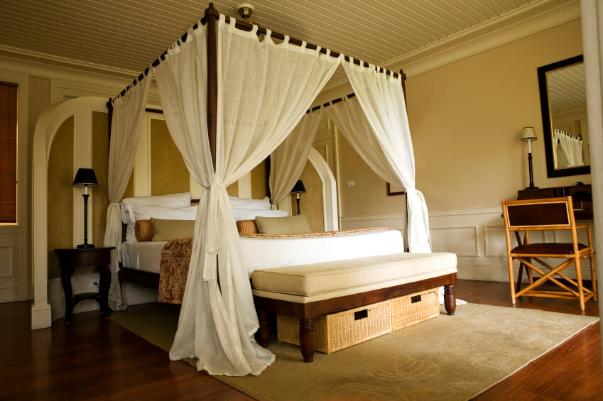 Light cotton curtains add tropical flair to this lovely master bedroom. A curved three- : curtain canopy bed - memphite.com