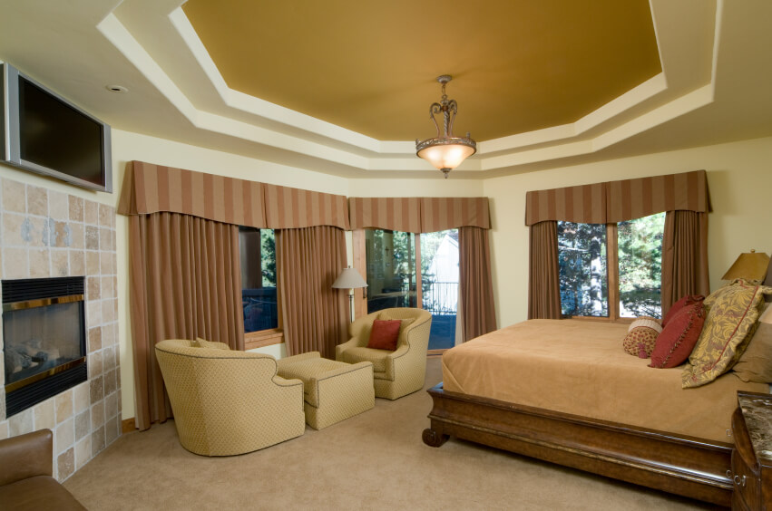 This Small Rounded Bedroom Makes The Best Use Of Its Small Size Using  Vertical Lined Drapery