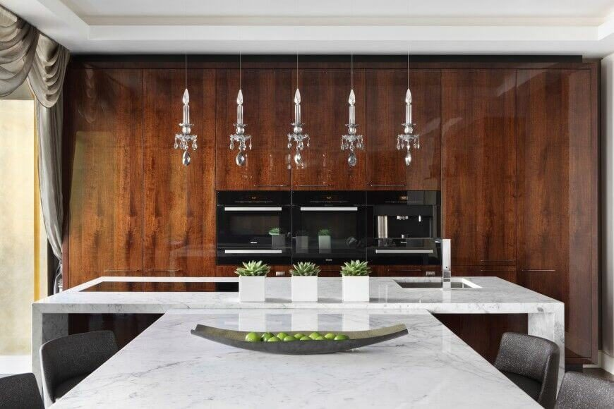 Here, Slim Appliances Are Nestled Into A Glossy Wall Of Rich Wood Cabinets.  A