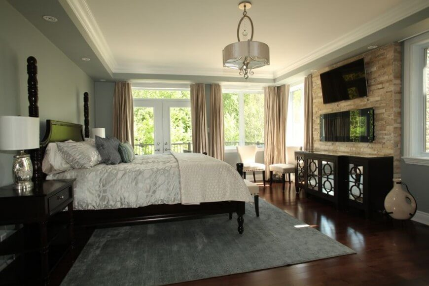 This Stunning Bedroom Features A Cherry Tone Hardwood Flooring That  Complements The Darker Furniture Nicely