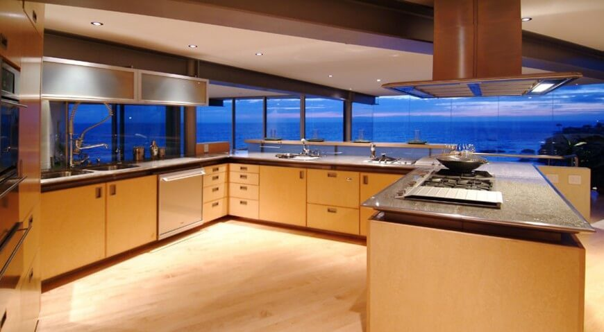 This Expansive, Open Plan Kitchen Enjoys Broad Views Of The Surrounding  Ocean Via Wraparound Glazing