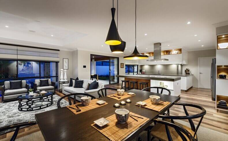 Darker Wood Tones Pull The Eye Around This Modern Living Room, Dining Room,  And