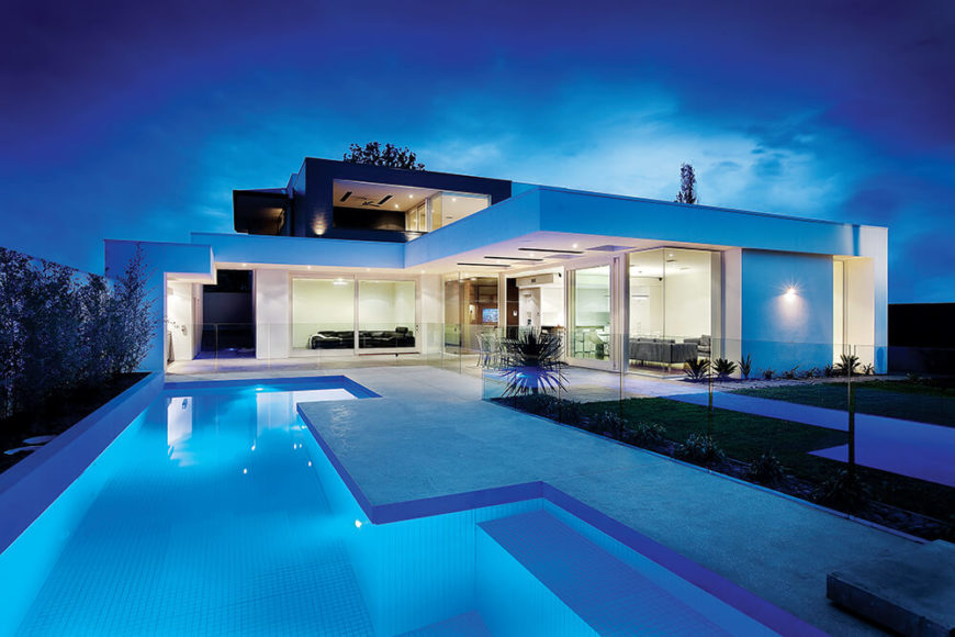 Modern home with integrated pool design and wraparound glazing.