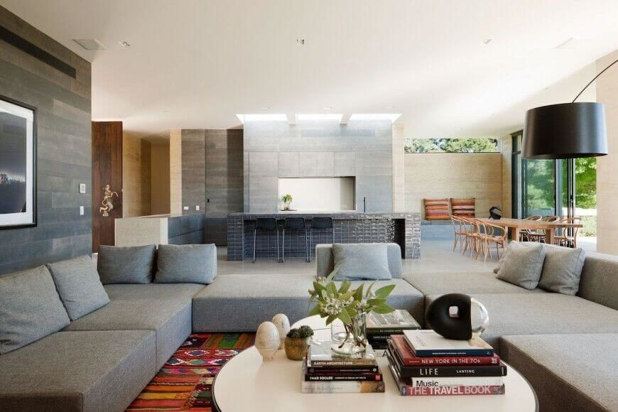 the smooth lines and textures of this contemporary open concept home are subtle decoration that