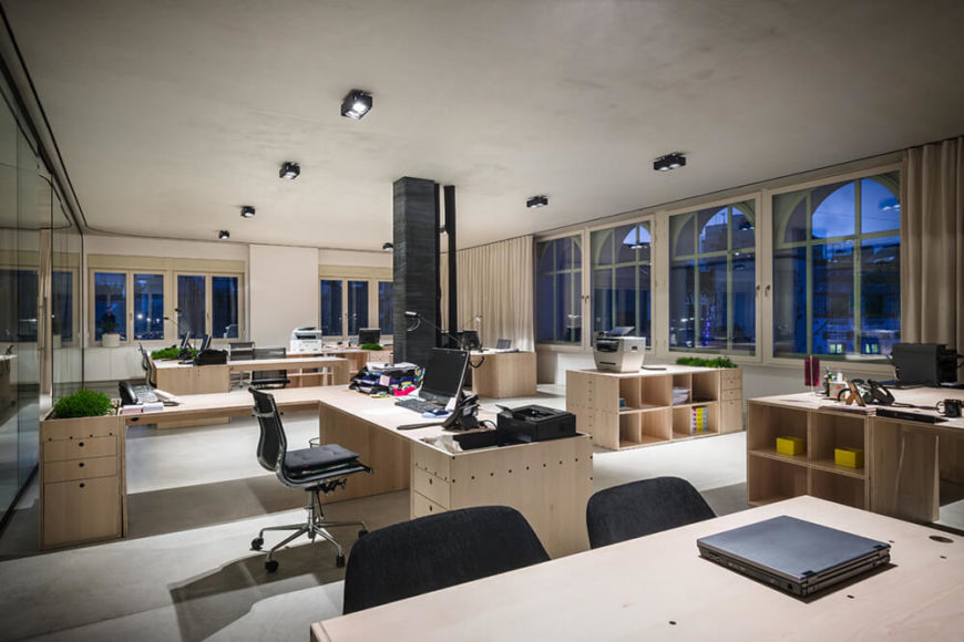The massive windows help to further establish a bright and open environment in the office, providing ample sunlight and expansive city views over Ljubljana. In this area we can see the myriad configurations that the desks are capable of.