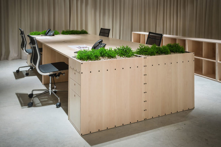 Here we have one of the elaborate desks with bespoke gardens built in. The drawer-top slabs of greenery afford an elegant zen-like calm and warm glow of life in a mostly minimalist expanse of modern space.