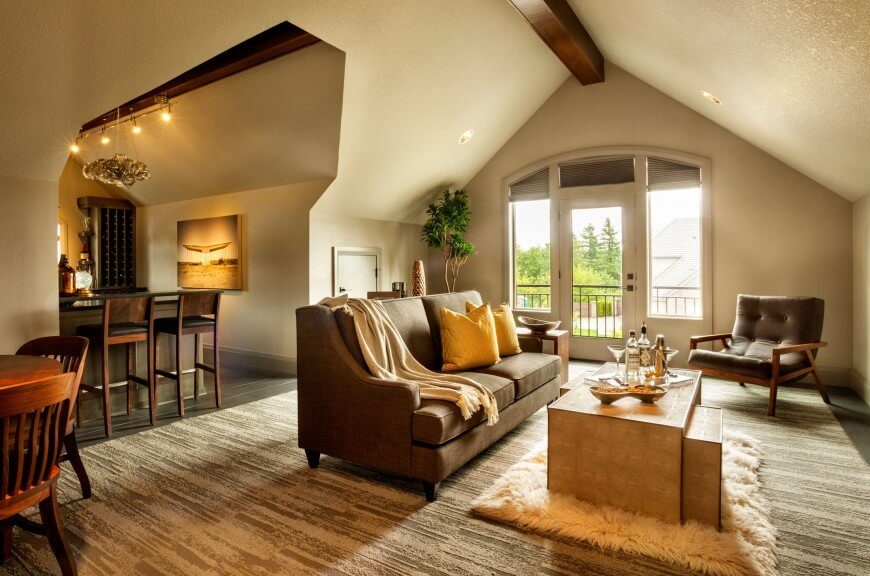 This room, is the complete opposite of the basement 'man cave' from above but utilizes the same color scheme. Yellow and gold accents are prevalent in both rooms but utilized in entirely different fashions. The arched ceiling gives this room an interesting atmosphere - cozy yet spacious.