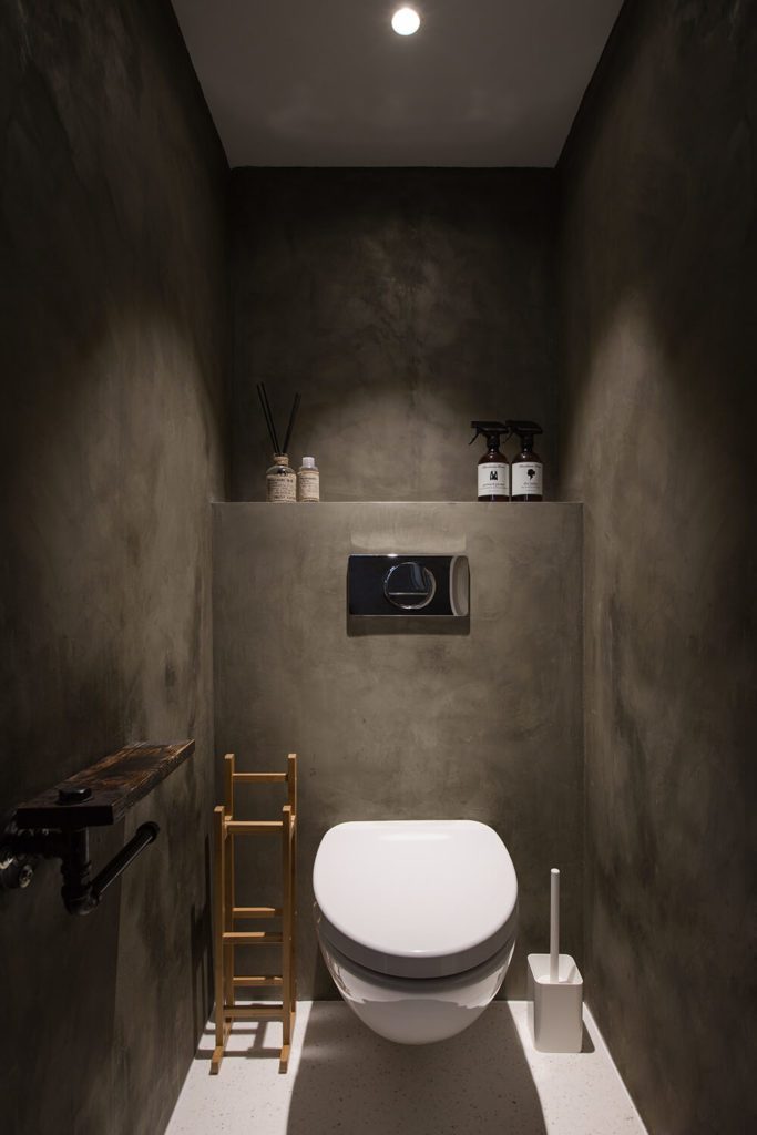 The individual bathrooms themselves are roomy spaces with full height dividing walls, perfect for extra privacy and making the bathroom more of an appealing escape from the busyness of the office itself. Grey walls and white tiled flooring provide simple but effective contrast.