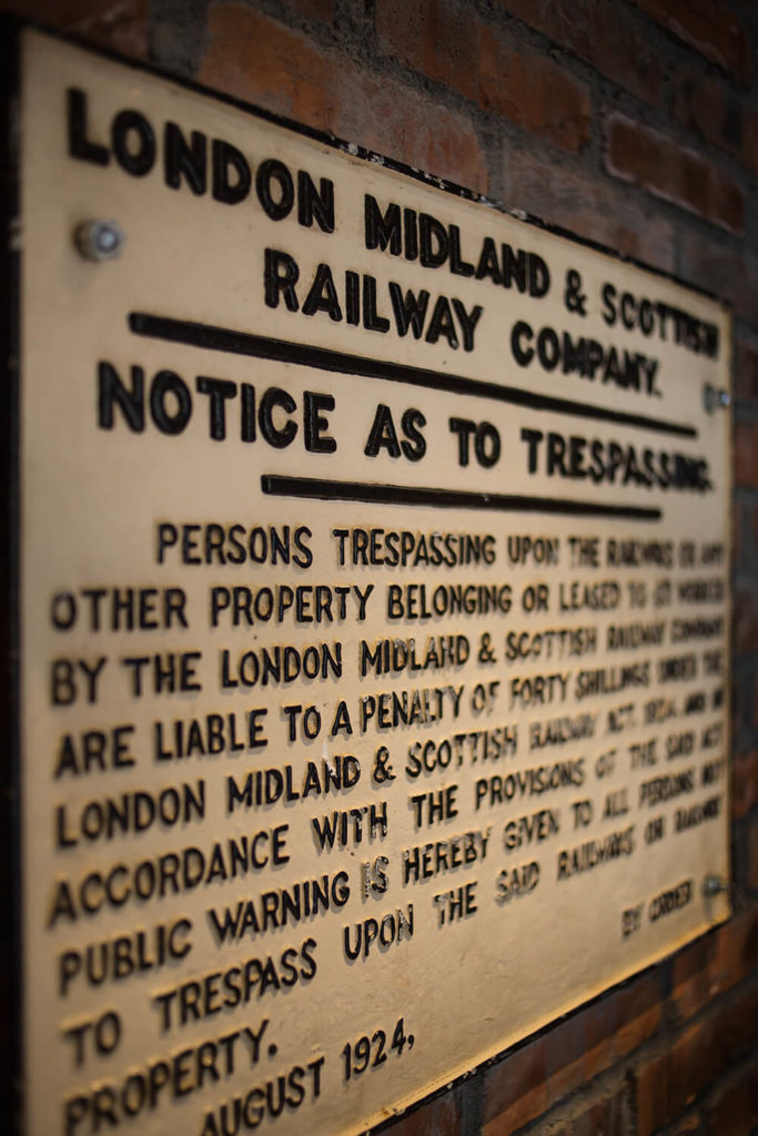 With this warning board, the source of the old fashioned signage surrounding the bathroom is revealed to be an old London railway station. Historical touches like this enhance the cross-generational appeal of the design.