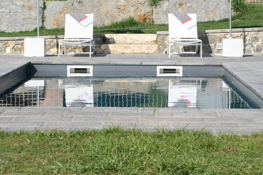 The guest house private pool comfortably hosts two and is attached to the house by a rustic stone patio.