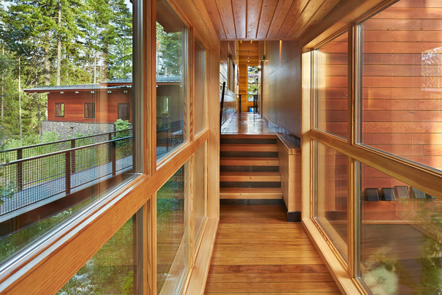 From this hallway that leads to the sleeping areas of the house, one can see the front walkway as well as out to the lake along the right side of the house.