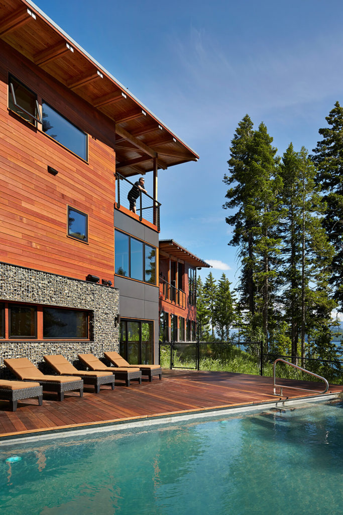 Outside the sleeping area is a large beautiful sun deck and refreshing infinity pool. This makes for a perfect place to relax or play while enjoying the surrounding nature. The sun deck matches the red stained wood of the rest of the house and continues the color scheme.