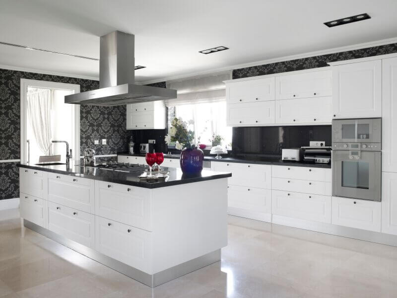 This Striking Contemporary Kitchen Utilizes Black Counters And Bold Accent Wallpaper To Break Up The