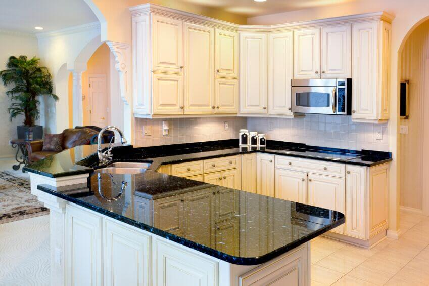 white cabinets black granite 36 Inspiring Kitchens with White Cabinets and Dark Granite (PICTURES) white cabinets black granite