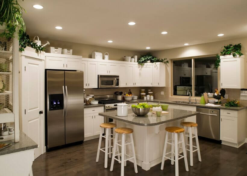 dark wood floors in kitchen white cabinets. Choosing counter tops to complement both the appliances and beautiful wood  floor gives this kitchen 36 Inspiring Kitchens with White Cabinets Dark Granite PICTURES
