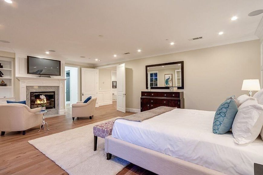 This Expansive Bedroom En Suite Features Light Natural Hardwood Flooring  And Soft Eggshell Walls, With