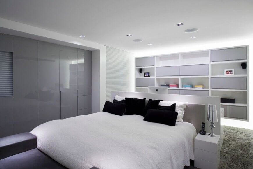 In A Sleek, Ultra Modern Bedroom Defined By White, The Central Bed Rests