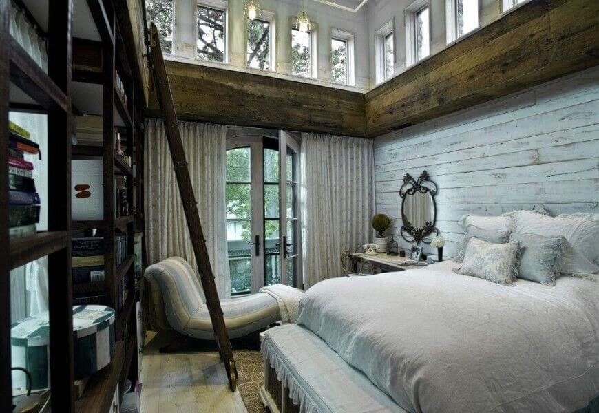 This Rustic Luxury Bedroom Features Aged Wood And Exposed Beams Below A Set  Of Wraparound Windows