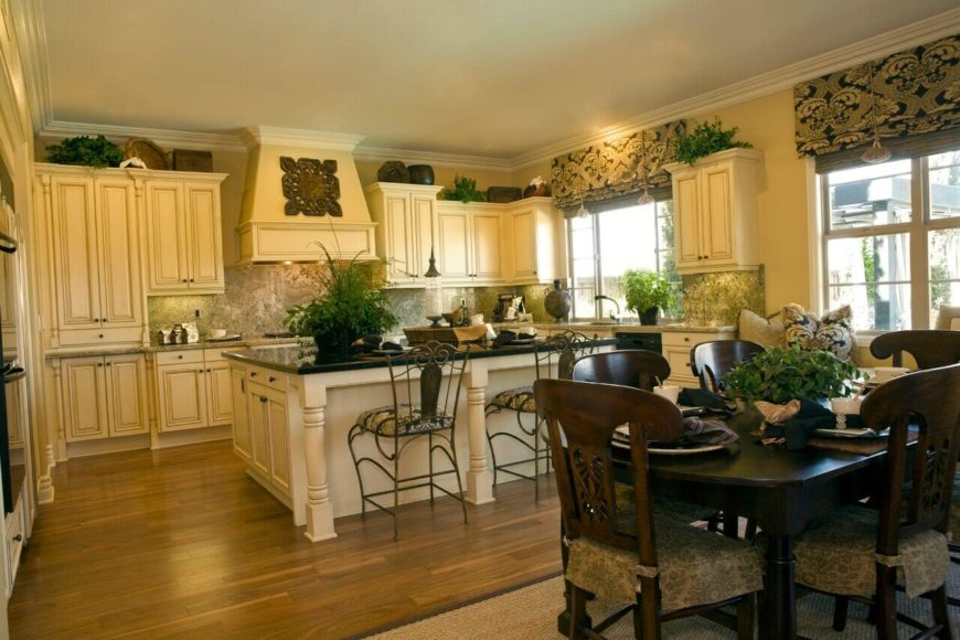The ornate cabinetry and island design in