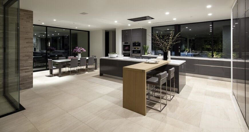 Large Format Beige Tile Flooring Underpines An Expansive Kitchen Design,  Features A Large Island With