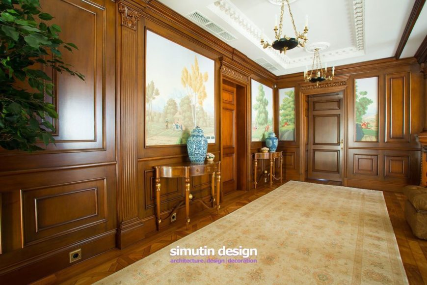 The second floor also plays host to a large gallery room at the top of the stairs, with small doors leading into each of the bedrooms. A soft rug covers the parquet floors.
