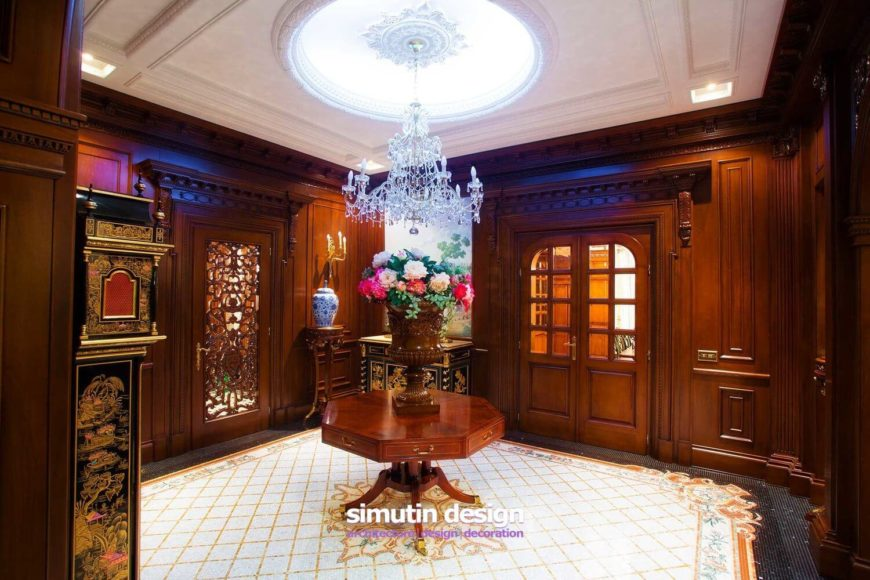 A final look at the beautiful hallway. Note the gorgeous East Asian Grandfather clock, hand painted. Also of note is the coffered ceiling with a lighted dome at the center.