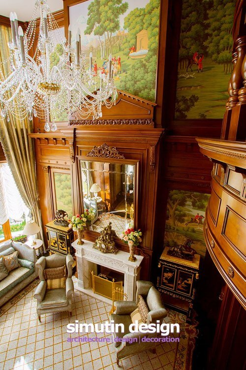 An aerial look from the second floor balcony down on the great room. From this height, we can see the murals that stretch up to the ceiling, along with the more delicate features of the chandelier.